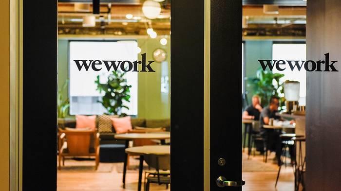 WeWork занимается коммерческой недвижимостью и воркспейсами