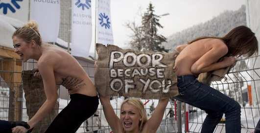 FEMEN в Давосе: эротические транспаранты